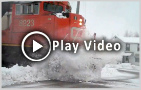 Train plows through snow bank